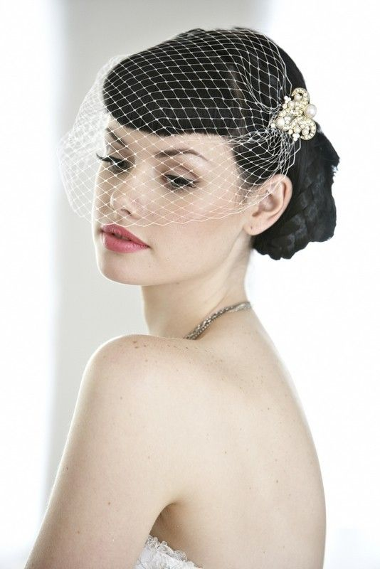 Love the retro bangs and birdcage veil combo....