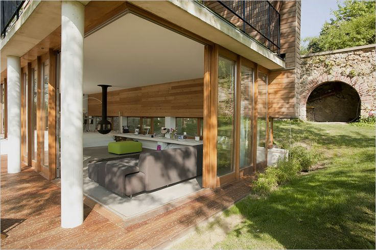 large sliding-glass panels in the living room help to blur the lines between the inside and outside