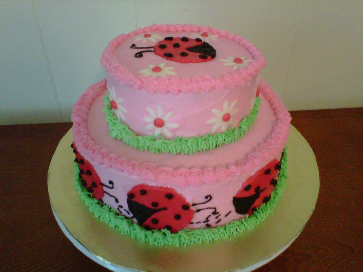 Ladybugs and daisies baby shower cake - 2 tier round cake made for a ladybug themed baby shower. Ladybugs and daisies are made out of fondant.