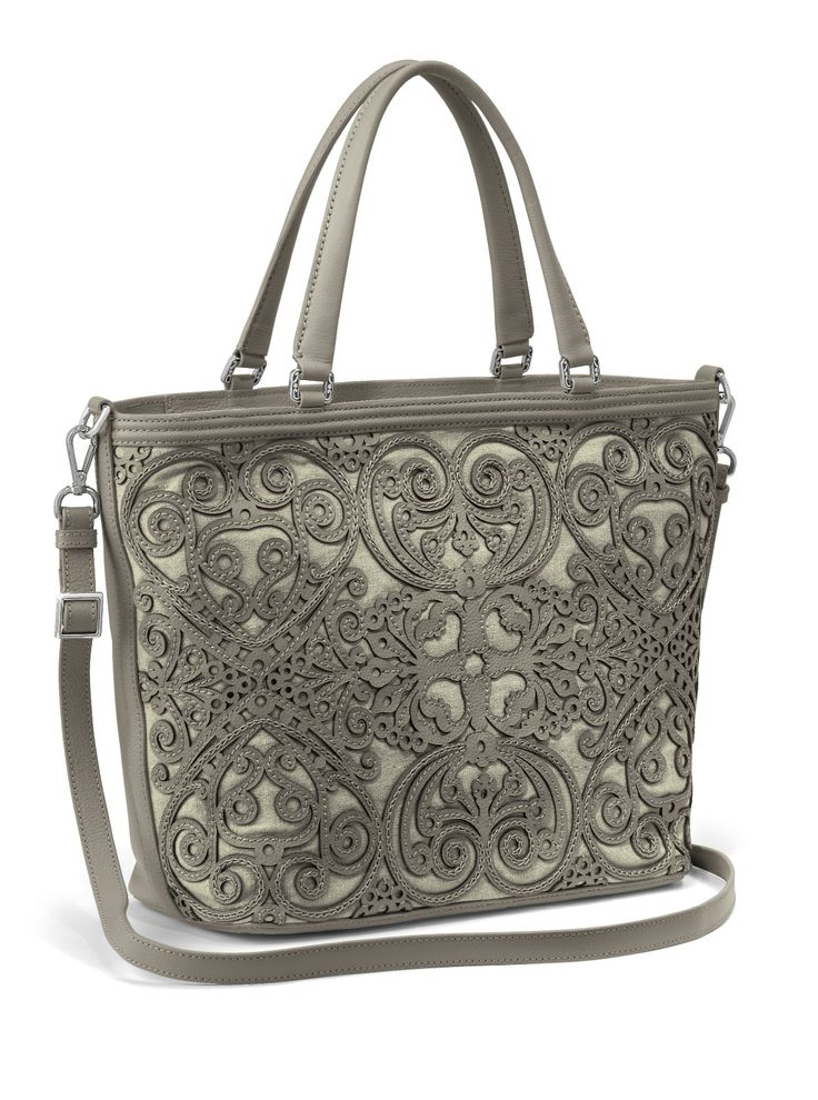 We used a lace-like laser cut leather, heavily stitched and overlaid on canvas, to make this Katusha tote the work of art you can carry everyday. Exquisite on the outside, organized on the inside - that's Brighton.