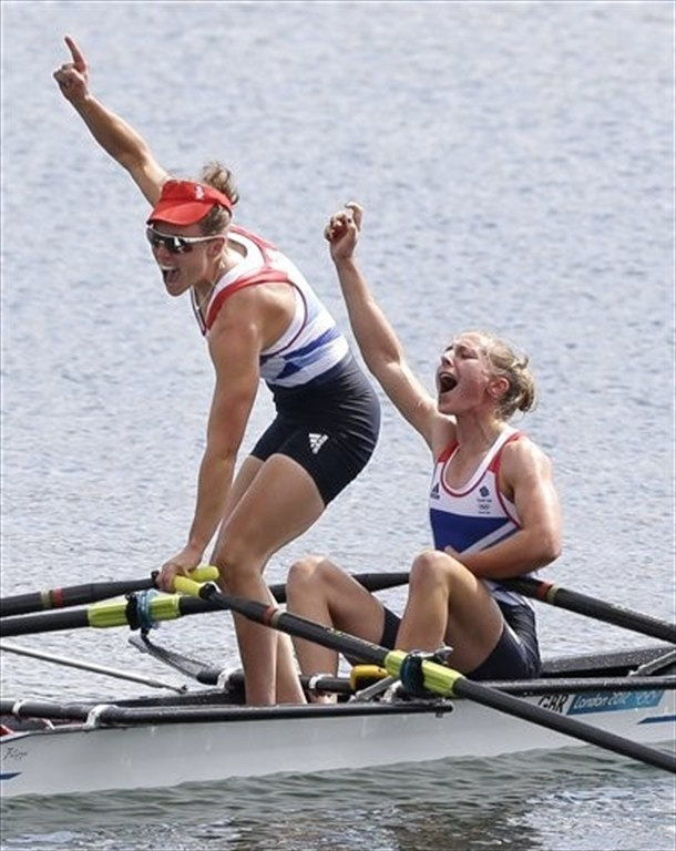 Katherine Copeland, left, and Sophie Hosking celebrate after winning gold for the lightweight women's rowing double sculls.