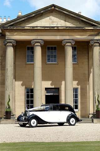 Classic vintage wedding car. Rise Hall, Yorkshire. Wedding venue in the UK.