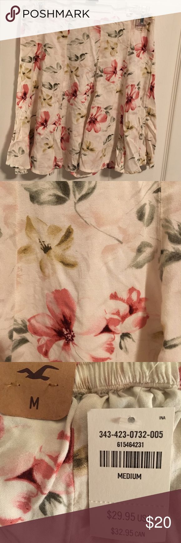 Floral Hollister Skirt NWT A white skirt with a pink and green floral print. Never worn and has tags. Hollister Skirts