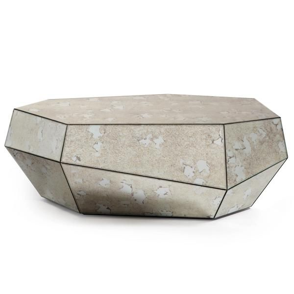 Designed by Architect Joana Santos Barbosa and handmade by Insidherland, the exclusive Three Rocks coffee tables in sleek black glass, bronze or aged mirror glass.