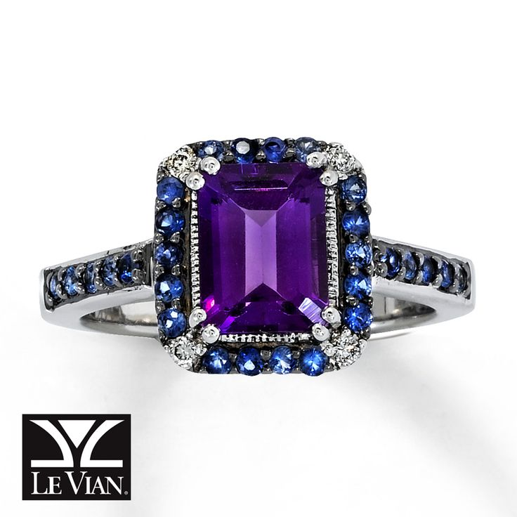Round sapphires encircle a vivid, octagonal amethyst in this fine jewelry ring for her. Vanilla Diamonds® accent the corners, while additional sapphires decorate the 14K Vanilla Gold® band. This lovely ring is also available at select Jared® locations. Call 1-800-527-8229 for the store nearest you. Available online while supplies last. Diamond Total Carat Weight may range from .04 - .06 carats.  Most natural gemstones pictured have been subject to an...