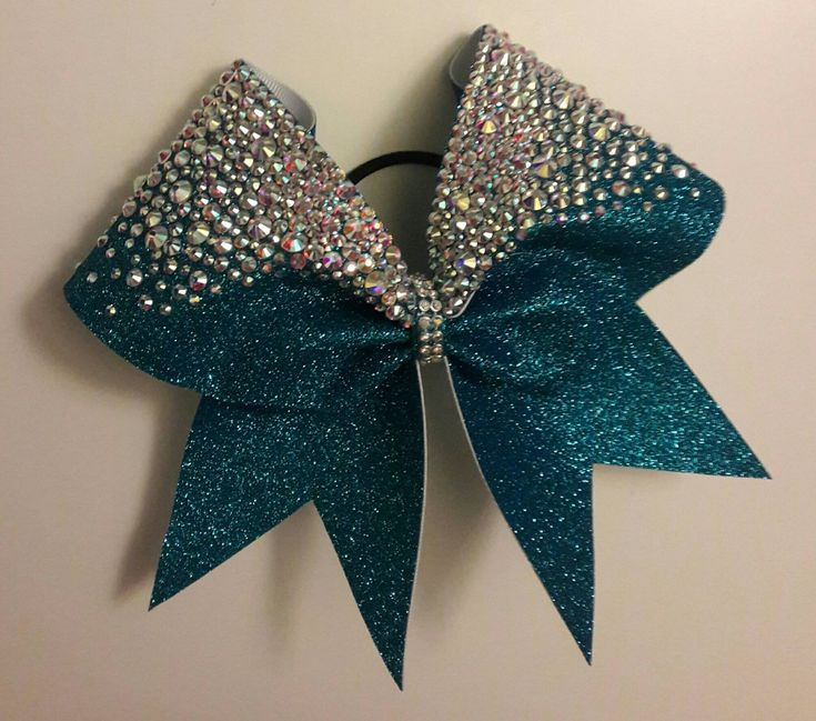 Full On Bling!!  Rhinestone encrusted full glitter cheer bow. Absolutely stunning. Can be made on non-glitter material at lower cost, please contact me for more information. Made with high quality Goody brand hair band.  *This is not a backpack bow and should be handled with care