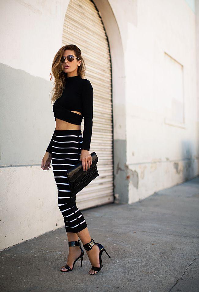 (Sunglasses - Gucci, Top - Jonathan Simkhai, Skirt - Balmain,  Clutch - Givenchy, Sandals - Saint Laurent)