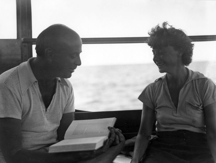 EH01515N  John Dos Passos reading aloud to Katy Dos Passos (?) aboard the Anita, 1932.