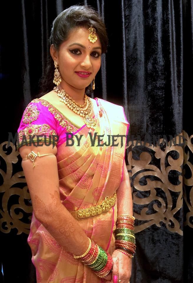 Traditional Southern Indian bride wearing bridal silk saree and jewellery. Reception look. Makeup and hairstyle by Vejetha for Swank Studio. #BridalSareeBlouse #SariBlouseDesign Silk kanchipuram sari. Tamil bride. Telugu bride. Kannada bride. Hindu bride. Malayalee bride Find us at https://www.facebook.com/SwankStudioBangalore