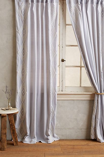 DIY Velvet Embroidered Curtain by Anthropologie - Why pay over $150 for window treatments. That's insane!  Get some grey sheer fabric.  Sew or use fabric tape to make your own curtain.  Finally, iron on this pattern, draw it on with paint, or stamp it on.