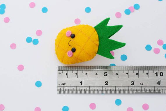 This listing is for a pineapple felt brooch with a happy smiling face! :)  *This brooch may look slightly different to the one pictured due to the handmade nature of the item.  SIZE: Measures 6.5 cm (2 1/2 inches)  MATERIAL: Each hannahdoodle brooch is hand-stitched. They are made using amazing quality 100% wool felt and stuffed with soft fibre filling.  SHIPPING: All items ship from the UK. International orders may take a little longer to arrive. (international orders can take around 2-...