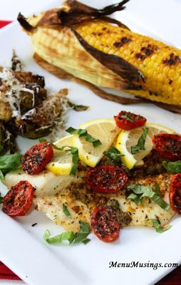 Grilled Tilapia with Lemon Basil Vinaigrette - lighten up your summer meal with a filet of grilled fish with this easy, flavorful citrus vinaigrette.