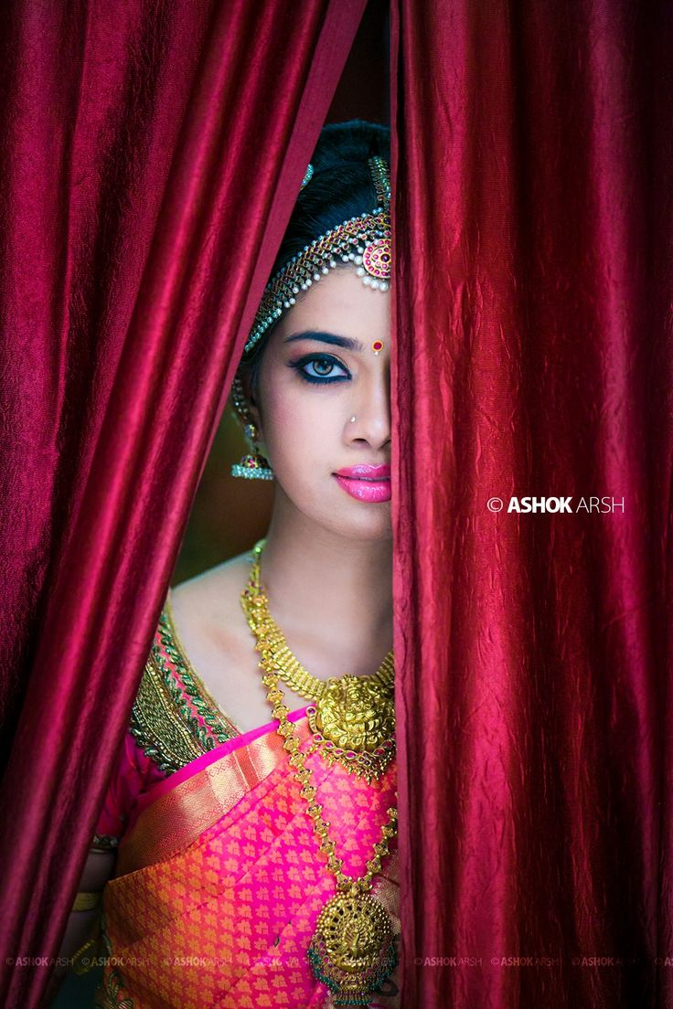 Indian wedding photography. Bridal photoshoot ideas. Candid photography. Traditional Southern Indian bride wearing bridal silk saree, jewellery and hairstyle. Temple jewelry. Jhumkis. Silk kanchipuram sari. Braid with fresh flowers. Tamil bride. Telugu bride. Kannada bride. Hindu bride. Malaya lee bride. #IndianBridalMakeup #IndianBridalFashion