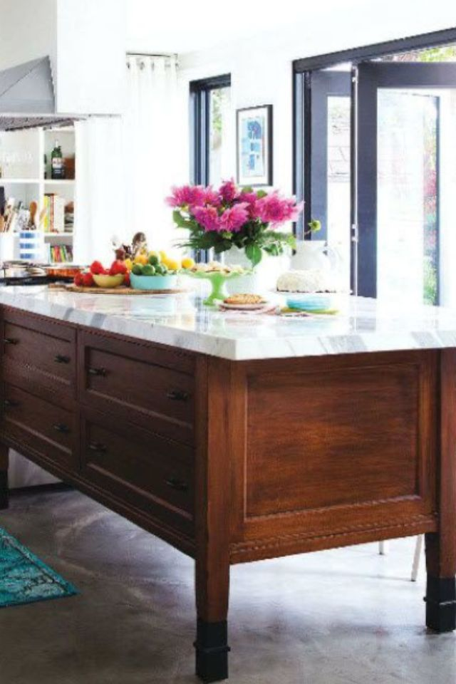 Love this island! Antique rustic table serves as an island or butcher block substitute