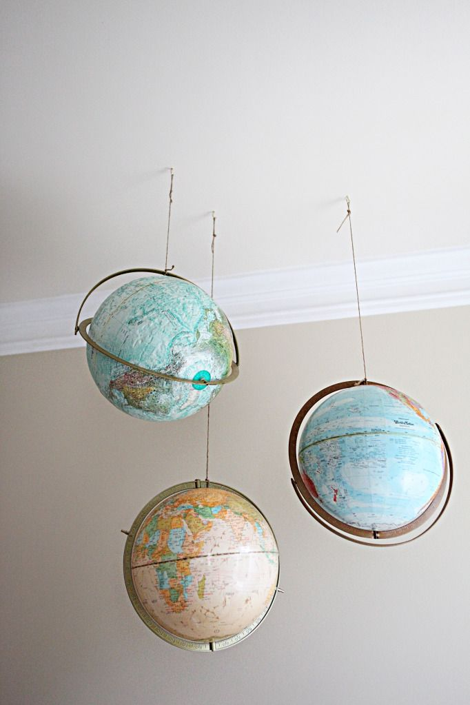 Hanging globes - bowerpowerblog. Love this idea. We use our globe fairly often but I don't have a good place for it. Remove the stand and hang it!