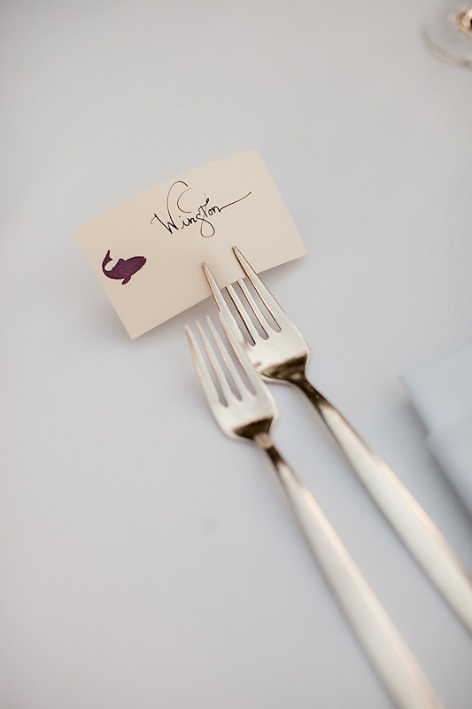 This is a neat idea for the placement card.  Have the fork, spoon, and knife sitting on the napkin (which is on the plate at the table.)