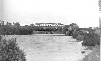 PH 13085. Flooded Yarra River at the South Yarra Railway Bridge, c1934.