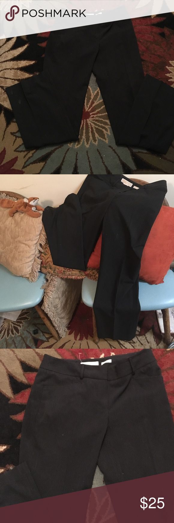 Great pair of Michael Kors work pants white stripe Great work pants that don't wrinkle!  Comfy to wear and look fantastic!  Michael Kors gramercy fit black with white pinstripes!  Had tag but the paper fell off... Michael Kors Pants