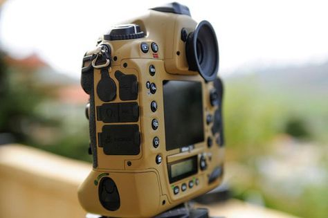 This military grade, desert camouflage painted Nikon gear is ready for action