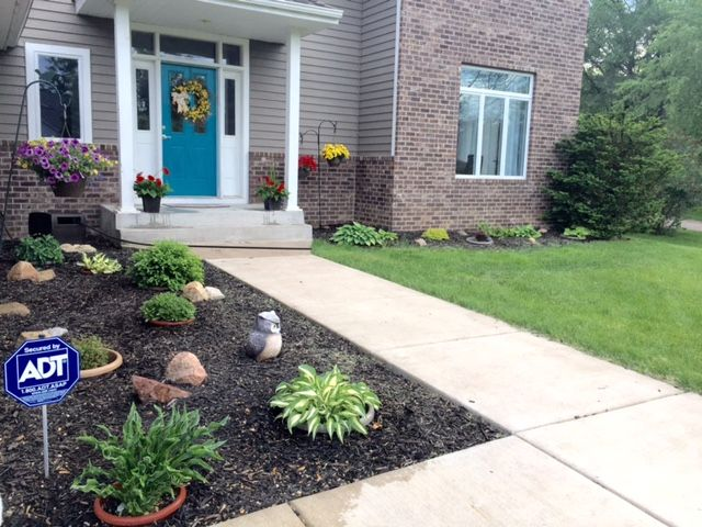 how to maintain your yard if you are not into it  bury pots in the ground and put plants in