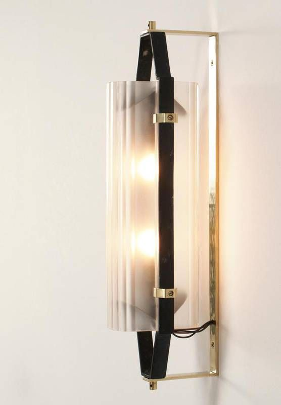 italian glass sconces with black structure and brass the sconces turns on its own axis