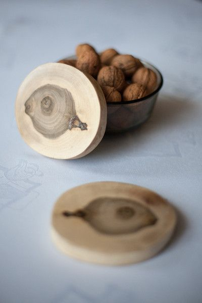 Walnut coasters by WoodenLand.  Coasters with walnut trees with a natural shape and color. Resistant to moisture and dirt thanks to the coverage of acrylic varnish and wax. Cut and polished by hand, stripped of bark.