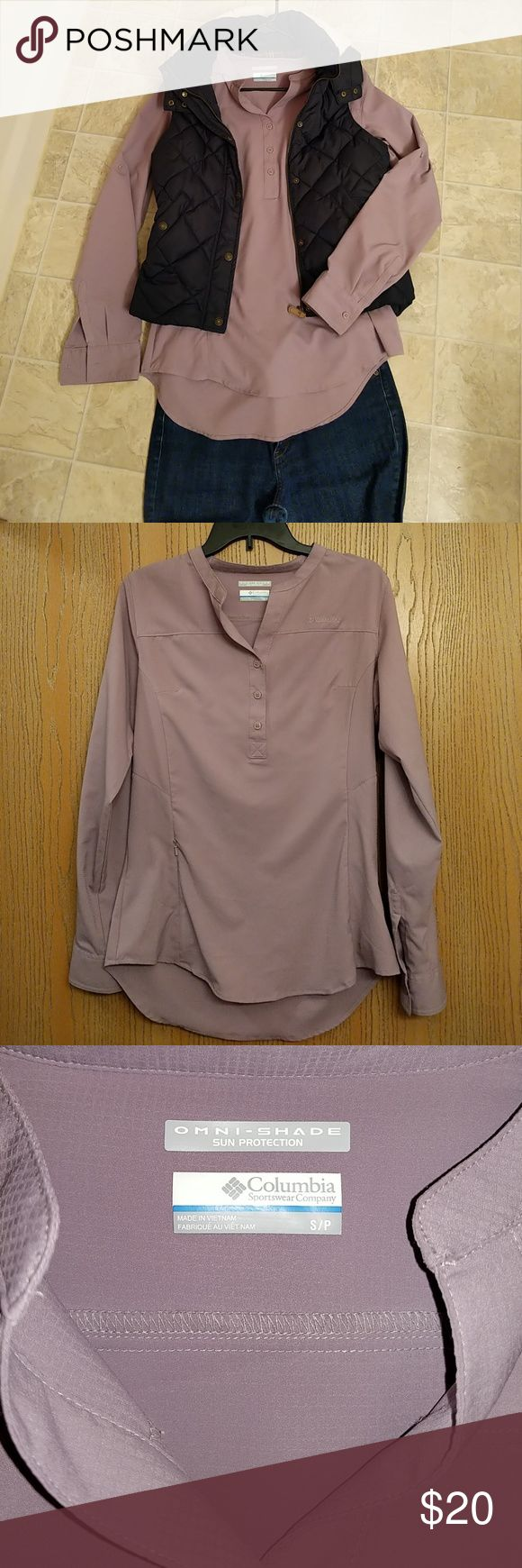 ☀️EEUC Columbia Omni-shade lavender tunic shirt ☀️EEUC Columbia Omni-shade tunic shirt in lavender. Embroidered logo on front and sleeve. Buttons on sleeves to roll up to make 3/4 length sleeves. Zipper pocket on right side. Only worn a few times. No snags or stains.  Offers welcome, hit the Offer button below. Columbia Tops Button Down Shirts