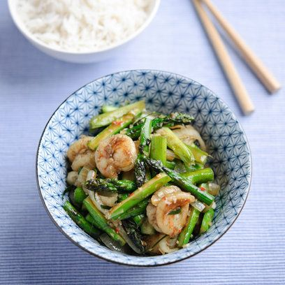Gizzi Erskine's asparagus, chilli, lemongrass and lime leaf stir fry with king prawns