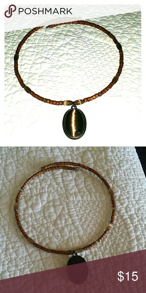 Choker Brown necklace with pendant. Extremely light weight. Back of the pendant is flat for comfortable wear. Jewelry Necklaces