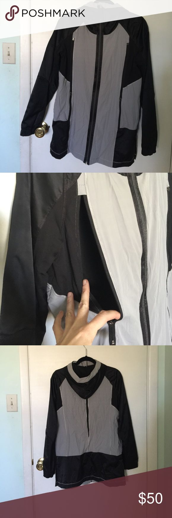 """Lululemon Right Round jacket 21"""" from armpit to bottom. According to Lululemon:  Why we made this: 1. A cozy, loose-fitting long-length jacket to throw on after you clip out 2. Stretch Glyde fabric is water-resistant and finished with DWR (Durable Water Repellant) to help repel the wind and rain 3. Anti-stink mesh and easy to pull zippers help you control your temperature 4. Store your cards and keys in the secure pockets 5. Lines with soft, moisture-wicking COOLMAX  This also has a phone…"""