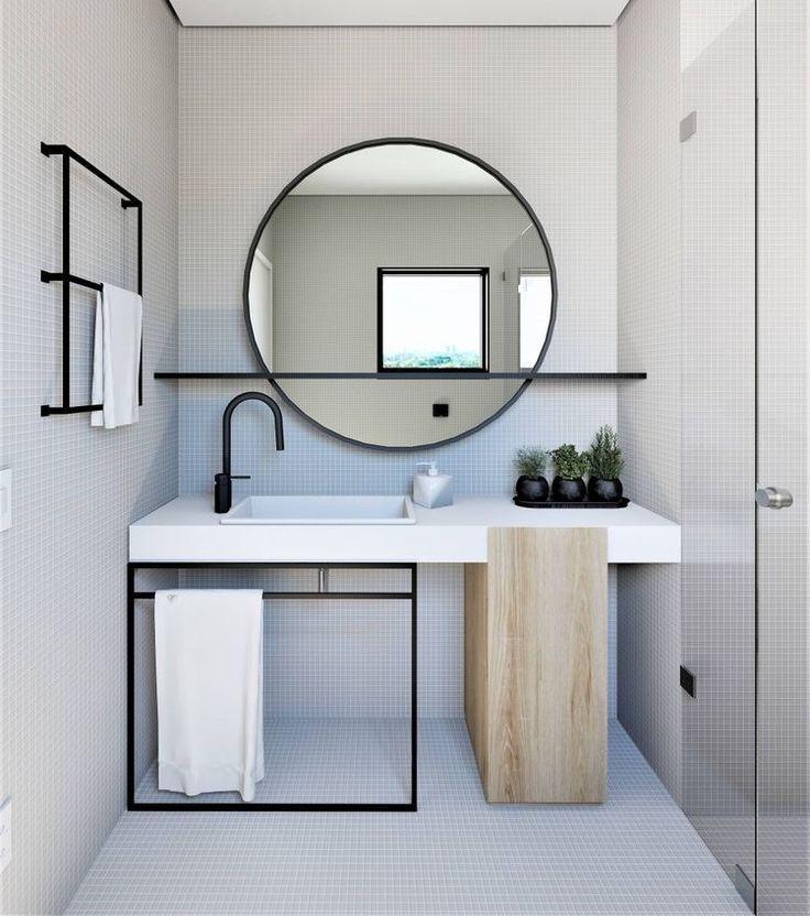 Spiegeleinfassung, Handtuchhalter, Waschbeckenboden und Armatur aus mattschwarzem Metall – cheryl khoury