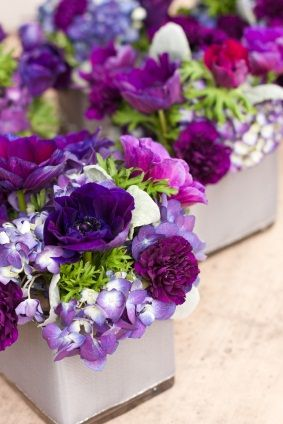 A mixture of light purple and dark purple carnations and anemones reception wedding flowers,  wedding decor, wedding flower centerpiece, wedding flower arrangement, add pic source on comment and we will update it. www.myfloweraffair.com can create this beautiful wedding flower look.