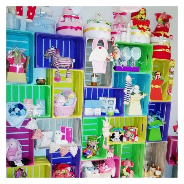 Display Area - Our bright crates filled with our handmade baby gifts & sweet soft toys.