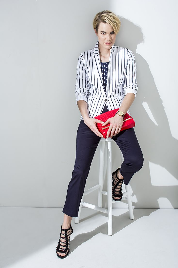 Everything Navy. Striped blazer worn with polka dot blouse and slim leg navy pants. And a red clutch handbag.