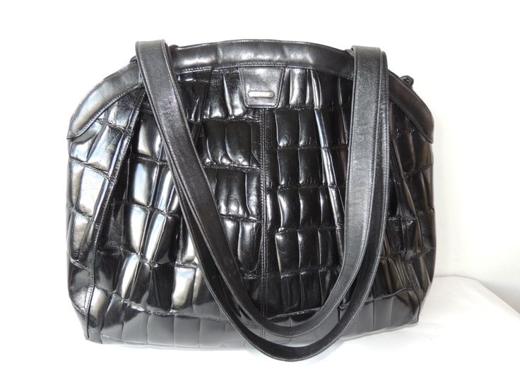 A wonderful huge crocodile bag made by Comtesse, we are in the 80's