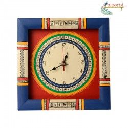 This blue red hand painted WARLI clock will definitely take you back to the ethnic era. The blue border and the red base has also been carefully hand painted to give a class and sheen. This wall clock will definitely accentuate the beauty of your home.