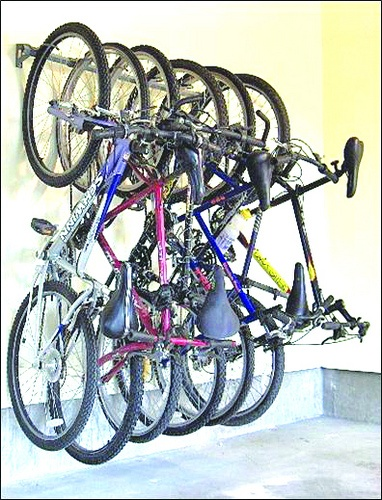 Bike Storage +++ maybe buy some large carabiners to hook hydration packs and hiking packs along steel bar for storage and drying them out after use