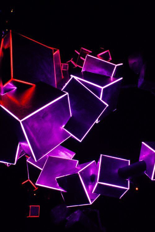 A light installation formed from a stack of intersecting cubes with edges made from neon tube lighting