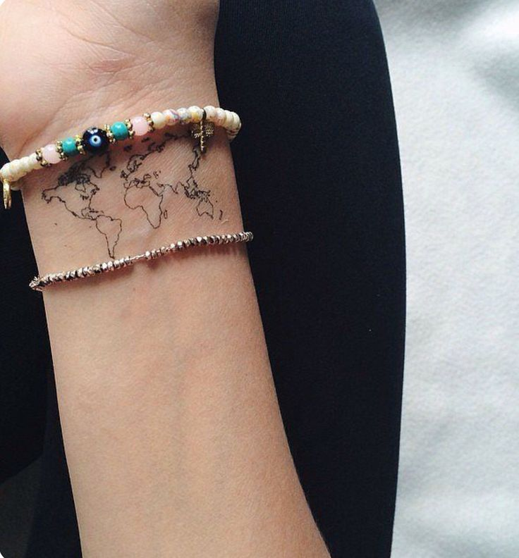 Map of the world tattoo. Perfect for a traveller.