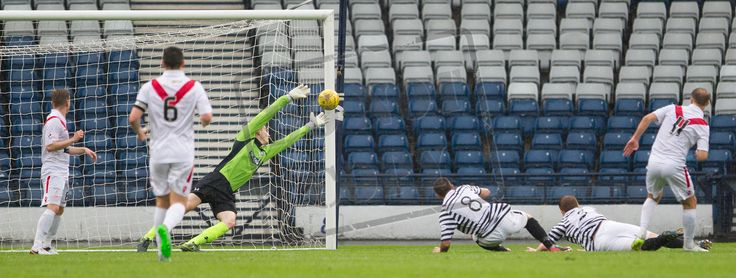 Airdrieonians' Ian Russell hits the ball into the net during the Betfred Cup game between Queen's Park and Airdrieonians.