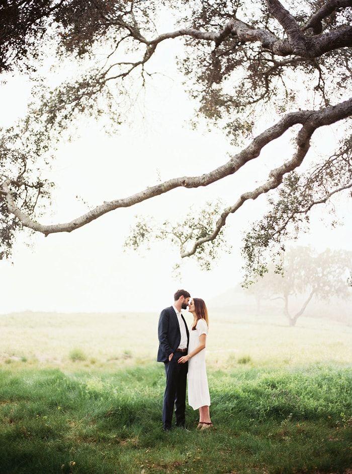 Underneath a tree.  #engagementphotos #weddingideas