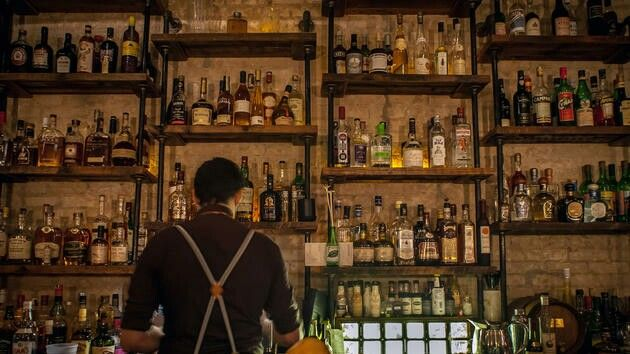 Bar with black pipe shelves
