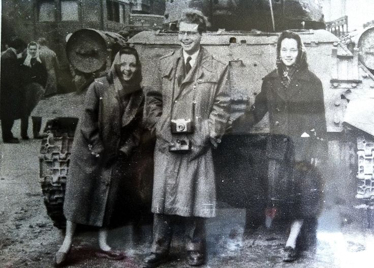 "Another pinner wrote: ""At left are my parents, Eva and Leslie Szego, in front of a Russian tank in Budapest in Oct. 1956. We escaped when I was 3 in Nov. My father was a pianist and we escaped not primarily because of the communists, but because of the anti-Semitism. Marianne Horrell."""