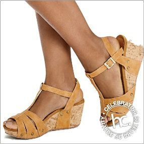 Her name is Nesi. She is comfy with a lightweight 6 cm cork wedge. Available in sizes: 4 - 8 Colour: black or tan
