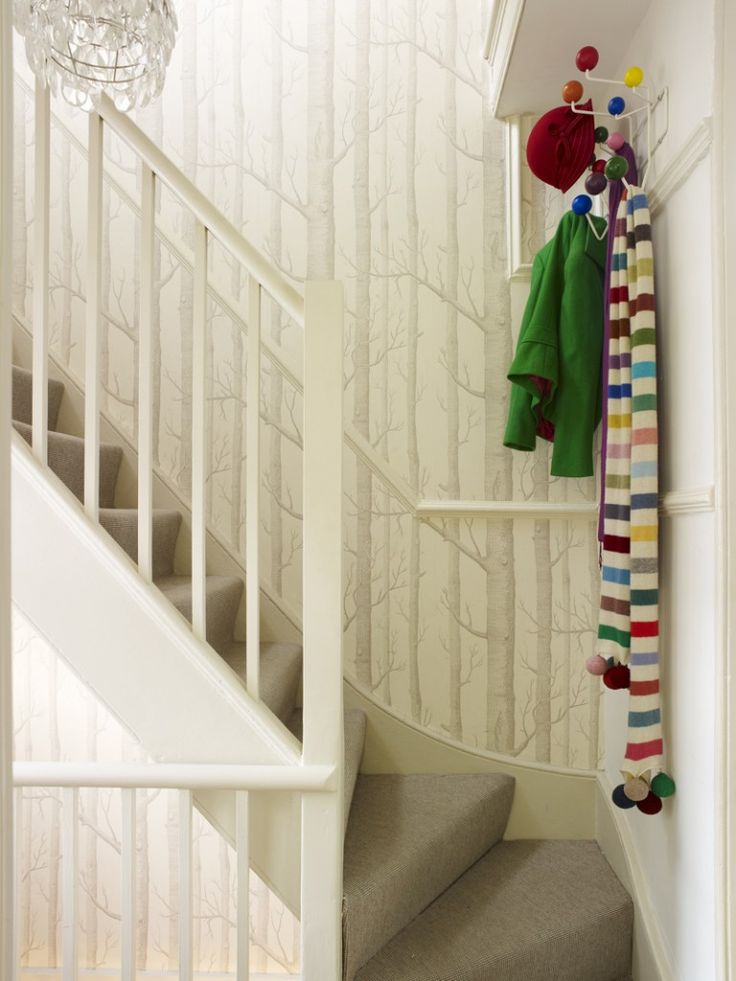Woods wallpaper by Cole and Son makes a striking statement throughout this 3 story house. Sweet Shop hallway by Sophie Robinson. Photo by Rachael Smith