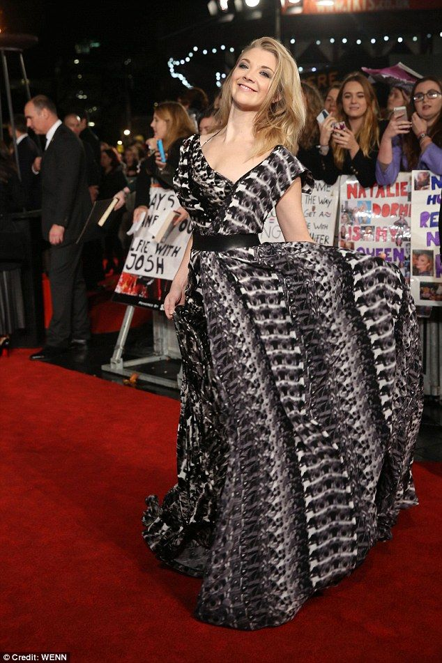 Natalie Dormer wearing Ong-Oaj Pairam asymmetrical eveningdress on the red carpet of the UK Premiere of The Hunger Games Mockingjay Part 2.