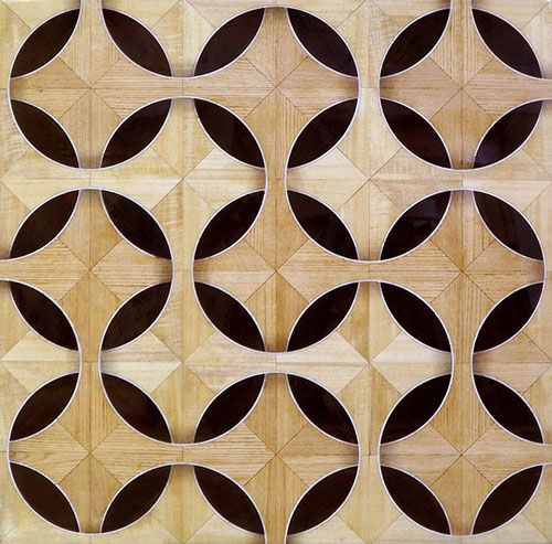 """""""Eclipse"""" wood parquet flooring. This 3D pattern is made out of wenge, maple, quartersawn oak and white marble."""