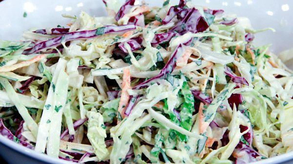 Foolproof Cabbage Slaw | Steven and Chris | This cabbage slaw from Chef Jonathan Collins is crunchy, tangy and refreshing. It's a perfect make-ahead side for a feast that includes his baby back ribs and tarragon potato salad. Ingredients Salad ½ head savoy cabbage, shredded ½ head green...