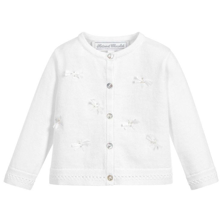 Charming cardigan for little girls by French brand, Tartine et Chocolat. Made in finely knitted cotton, it has a soft, lightweight feel. There are pretty mother of pearl buttons to fasten, and lovely beaded dragonfly appliqués.