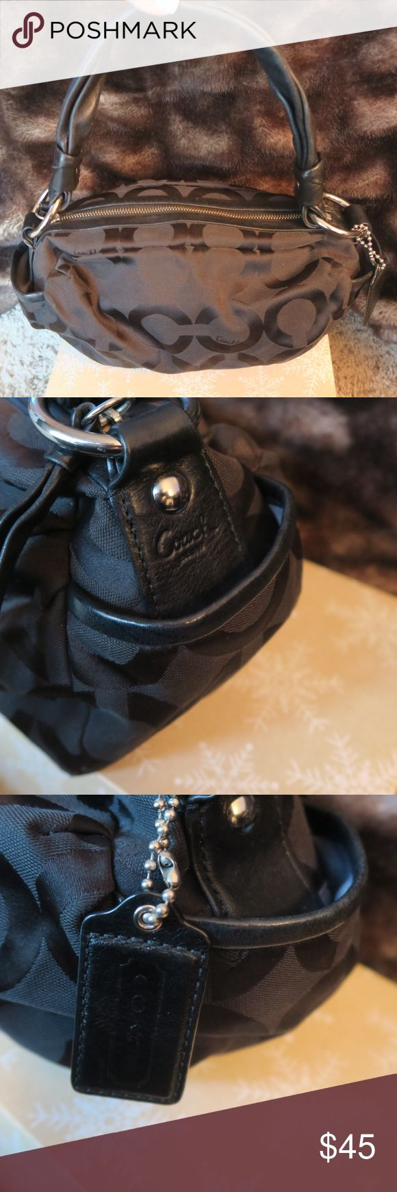Black Coach Handbag Black coach bag. Material is canvas but strap is leather. Silver metal details. Bag is authentic and I am it's first and only owner. Great condition. Inside of bag pulled out in photos 5 & 6 so you can see how it looks. Hardly any wear shown. Comes with little Coach keychain. Strap is 23 inches long from bottom of metal loop to the other metal loop. Bag is 15 inches long by 6 inches wide and 6 inches deep. Make me a reasonable offer. Willing to work on the price. NO…